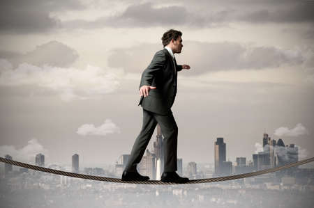 Businessman is balancing on a rope Stock Photo - 13230525