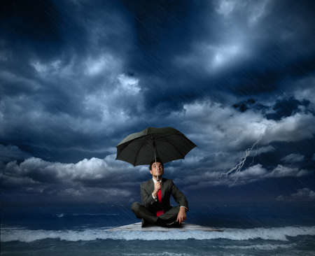 under water: Businessman on a raft in the storm