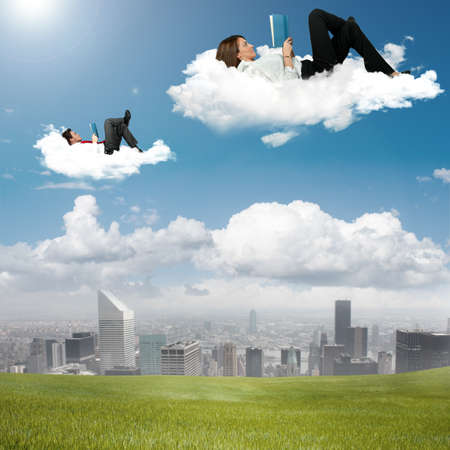 Business people reading book in the sky Stock Photo - 13618053