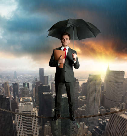 business metaphor: Insurance concept with businessman on the rope Stock Photo