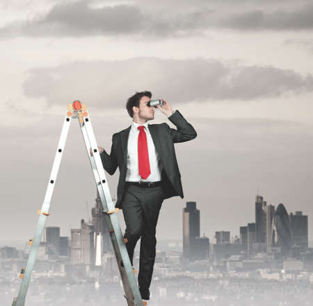 binoculars: Businessman looking for new business Stock Photo