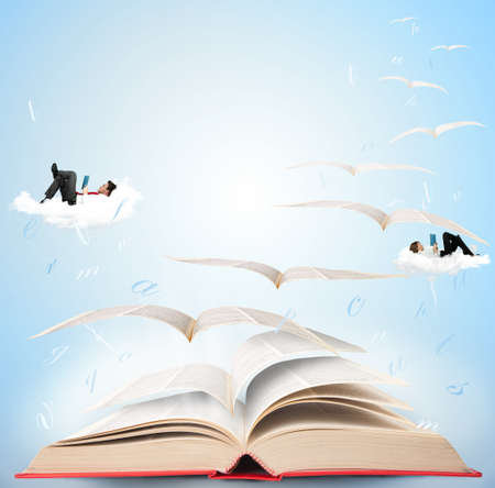 mystical woman: Fly with fantasy reading a book Stock Photo