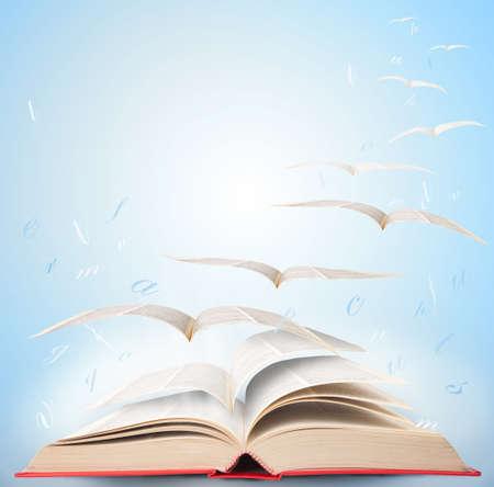 bird fly: Fly with fantasy reading a book Stock Photo