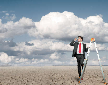 Businessman in search of business in a desert photo
