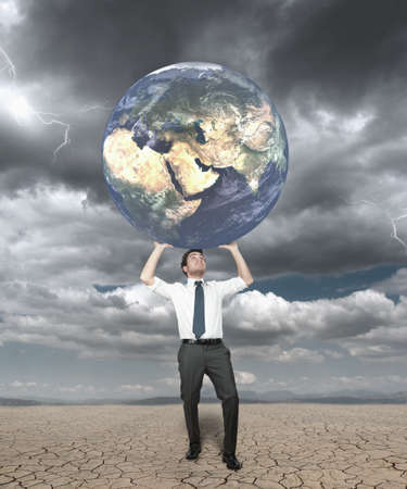 Businessman protects the world from the storm Stock Photo - 14095278