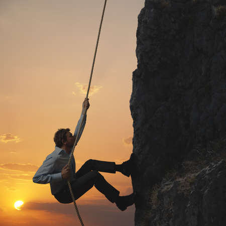 climbing sport: Business man climbs a mountain
