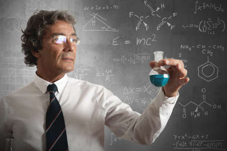 Businessman takes the chemical formula for the success photo
