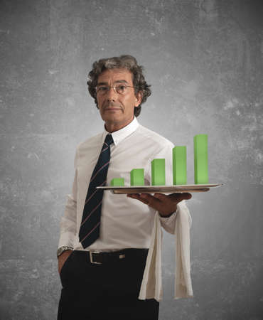 Businessman holds a tray with positive statistics photo