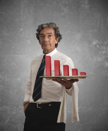 unfavorable: Businessman holds a tray with negative statistics Stock Photo