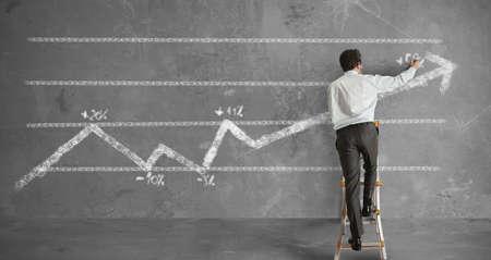 Businessman draws a statistical trend line Stock Photo - 14525525