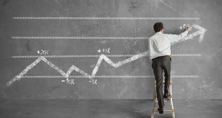 Businessman draws a statistical trend line photo