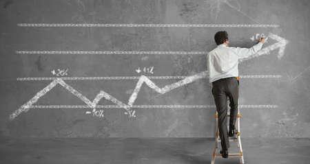 Businessman draws a statistical trend line photo