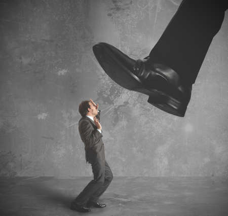 burdened: A businessman burdened by heavy taxes Stock Photo