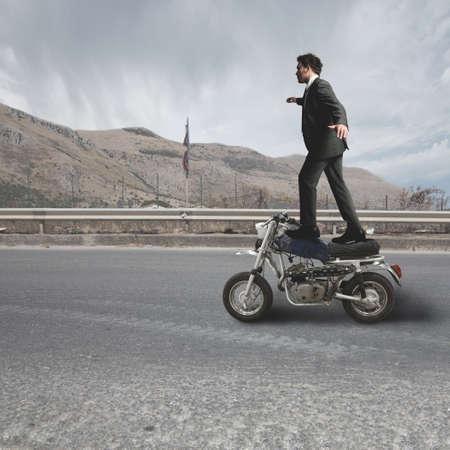 A businessman does dangerous stunts