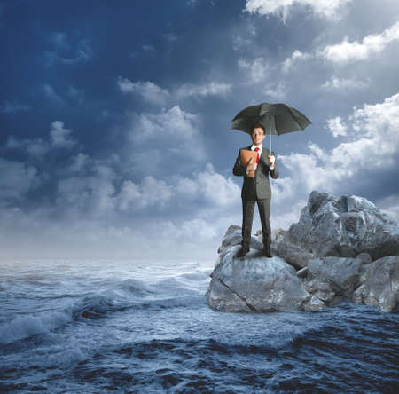 Concept of insurance protection with agent on the rocks Stock Photo - 14902896