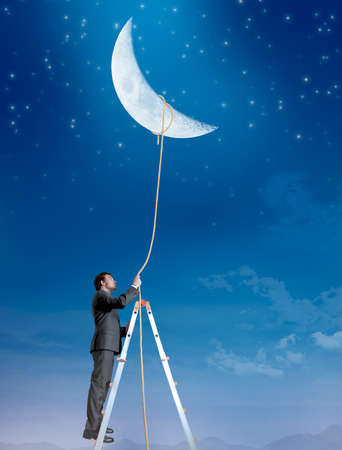 obtain: Concept of a businessman that wants the moon Stock Photo
