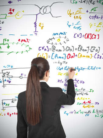 Businesswoman drawing formula in a whiteboard Stock Photo - 14902890