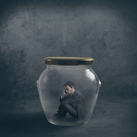hermetic: Be emetic concept with a businessman closed in a jar