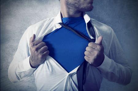 Concepto de ser Superman en los negocios Foto de archivo