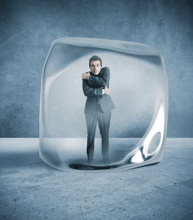 freeze: Frozen businessman blocked in the ice Stock Photo