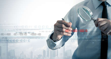 magnifying glass man: Businessman search the virus in a binary code Stock Photo