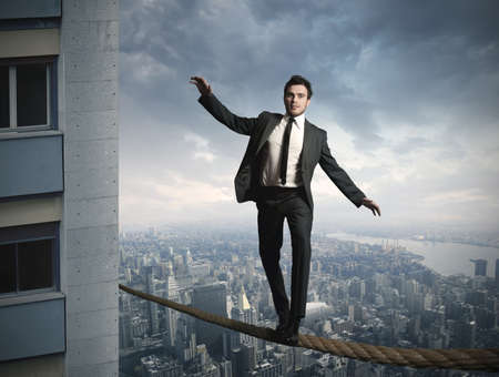 Equilibrist businessma on the rope photo