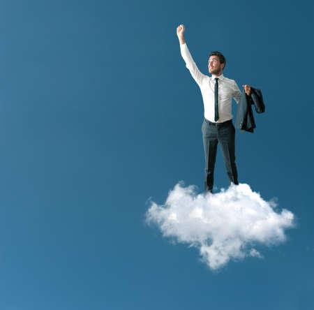 El éxito de un hombre de negocios en una nube Foto de archivo