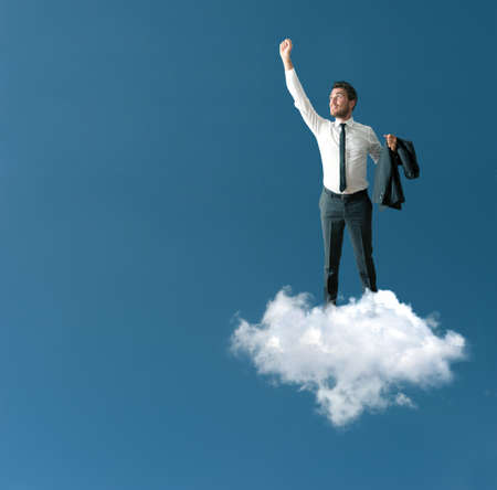 concept conceptual: Success of a businessman over a cloud