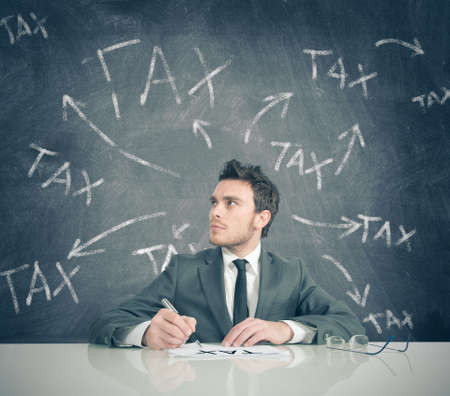 delusion: Concept of businessman and tax problem Stock Photo