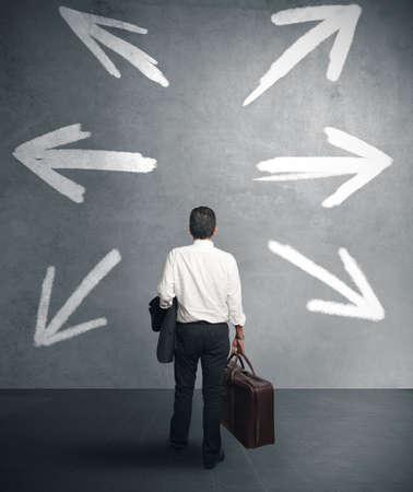 back arrow: businessman must choose between different destinations