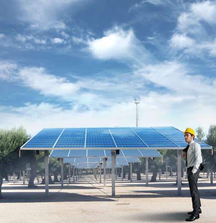 sustainable energy: Businessman against an installation of solar panel Stock Photo