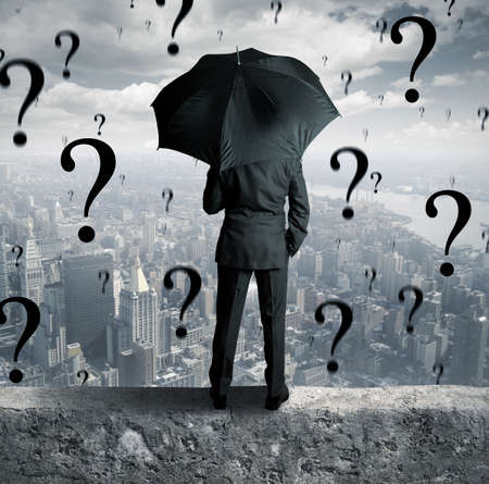 doubt: Concept of businessman surrounded by questions
