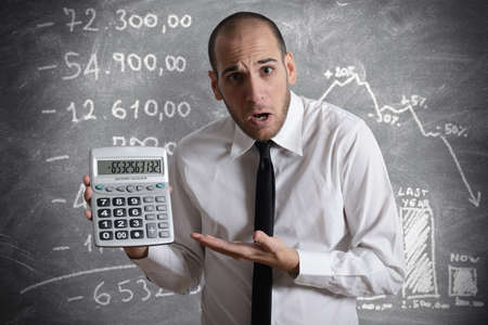 calc: Businessman show negative number of tax and crisis Stock Photo