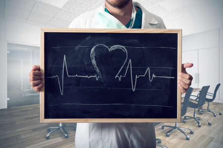 heart rate: Doctor show heart graph in a blackboard Stock Photo