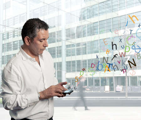 Businessman writing with touch screen phone Stock Photo - 16252824