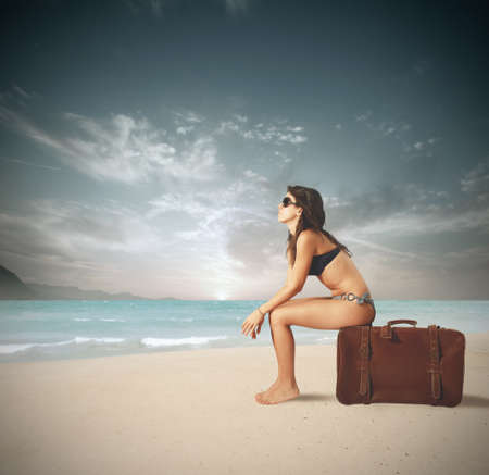 beach towel: Girl ready to travel with the bag