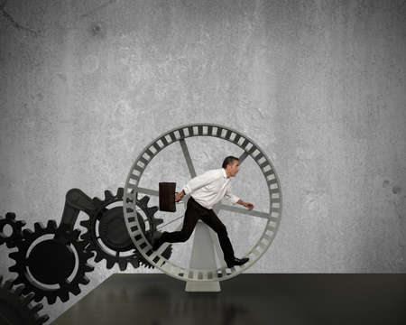 Businessman running in a business power generator Stock Photo - 16252830