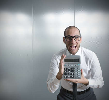 calculating: Businessman show calculator with positive value Stock Photo