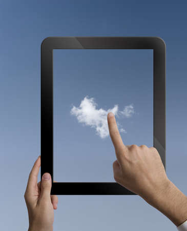 concpet: Concpet of cloud computing with  a tablet Stock Photo