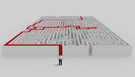 easy way: Businessman in front of a maze with solution Stock Photo