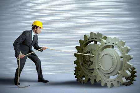 Businessman turning a gear system with rope Stock Photo - 16828190