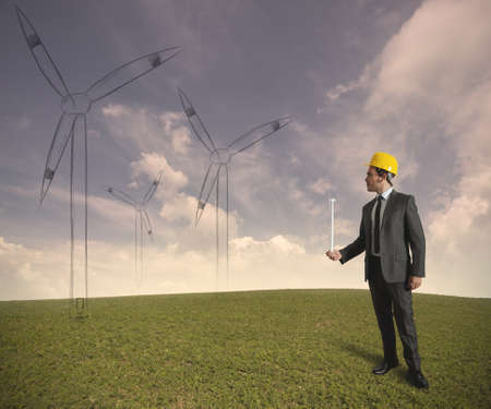 Concept of businessman that plans a wind turbine project Stock Photo - 16828189