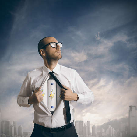 transform: Concept of power in business with battery pack under the shirt