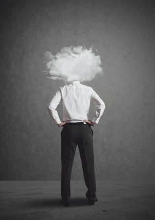 distracted: Concept of businessman with head in the clouds