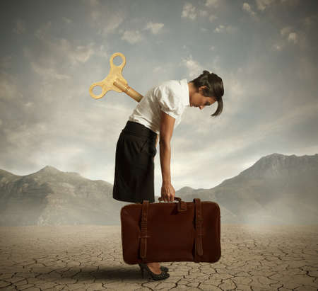 woman hard working: Concept of an exhausted businesswoman in a desert