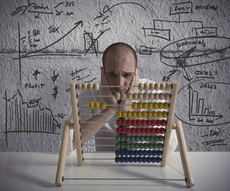 an abacus: Businessman with ecominic problems for the crisis Stock Photo