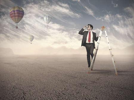 job opportunities: Businessman looking for new job opportunities