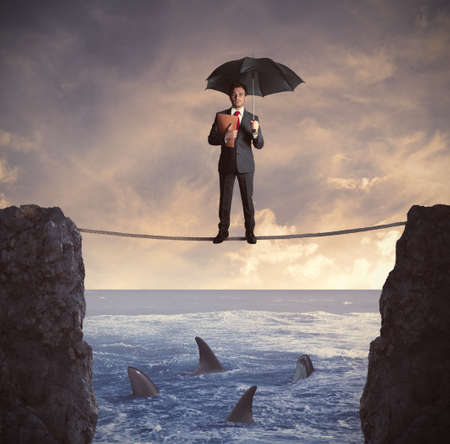 Concept of insurance with businessman on the rope photo