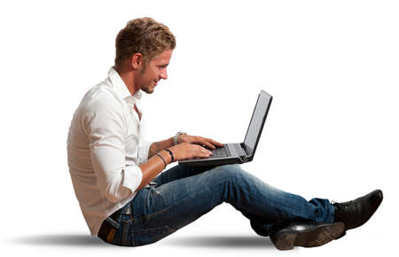 Isolated businessman working with laptop Stock Photo - 17347117