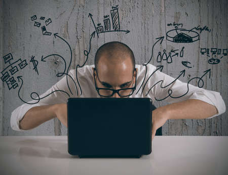 programm: Businessman working with laptop on new projects Stock Photo